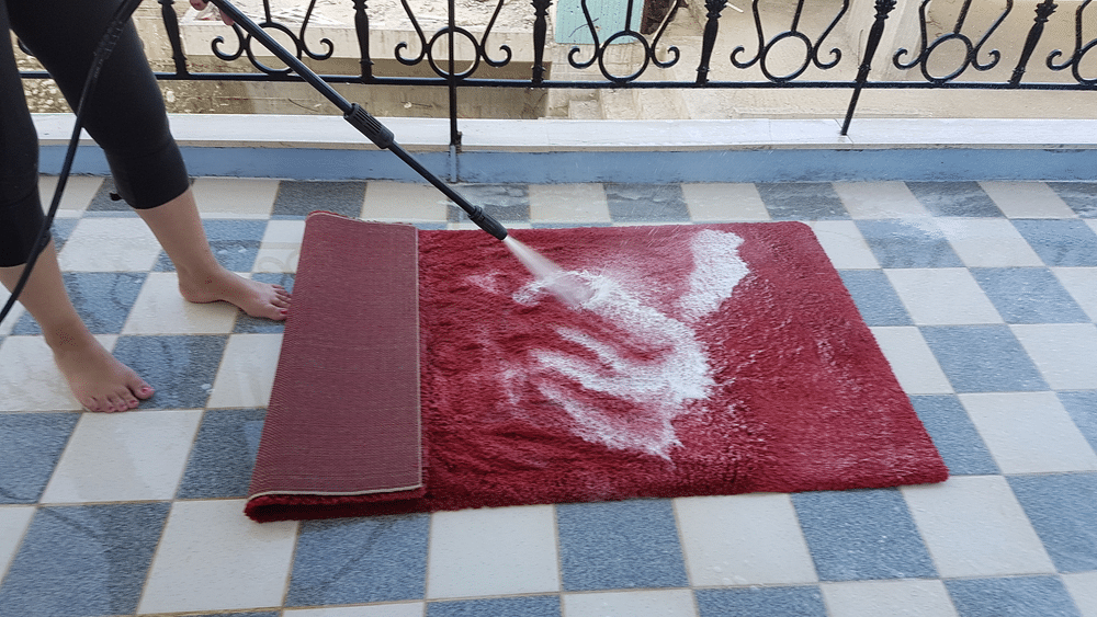 Using a power washer can make cleaning rugs an easy chore to do